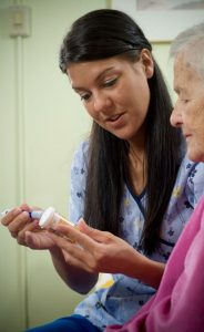 Medication Aide Consulting With an Elderly Woman